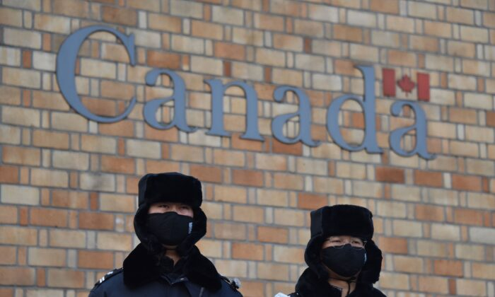 Chinese police officers stand guard outside the Canadian embassy in Beijing on Dec. 10, 2018. (Greg Baker/AFP via Getty Images)