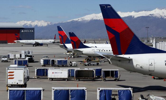 Delta Airlines planes are loaded and unloaded at Salt Lake City International Airport in Salt Lake City, Utah, on April 14, 2020. (Jim Urquhart/Reuters)