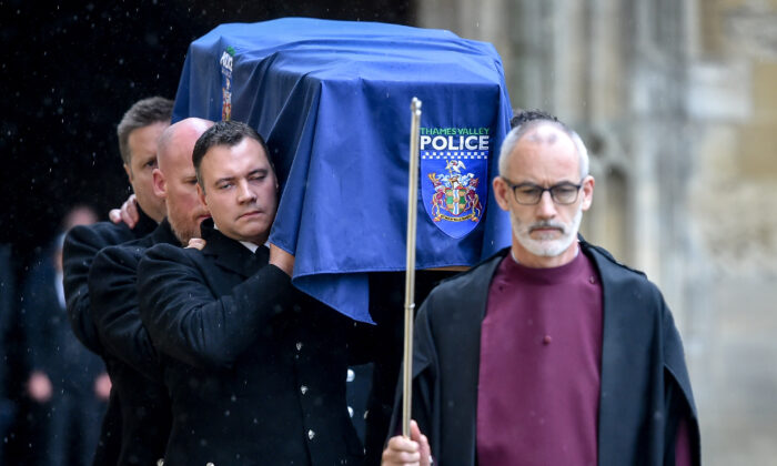 Clergy lead the pallbearers as they carry the coffin of PC Andrew Harper during his funeral at Christ Church Cathedral in Oxford, England, on Oct. 14, 2019. (Ben Birchall - Pool/Getty Images)