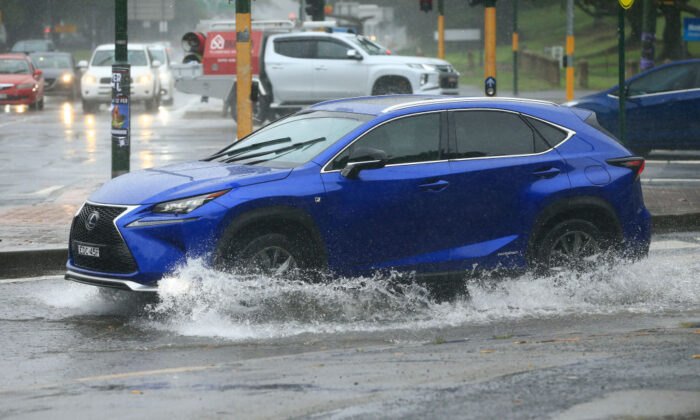 Cars travel through flooded roads on February 09, 2020 in Sydney, Australia. (Mark Evans/Getty Images)