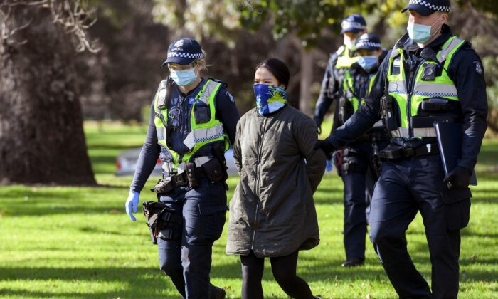 Police detain a protester in Melbourne, Australia, on July 31, 2020. (William West/AFP via Getty Images)