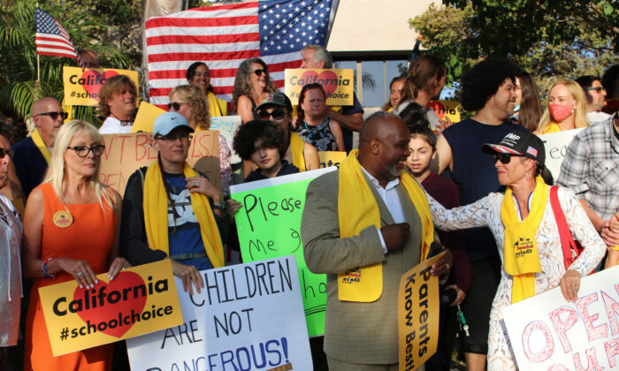 Parents assemble at a rally calling for the reopening of Orange County schools in Santa Ana, Calif., on Aug. 4, 2020. (Jamie Joseph/The Epoch Times)