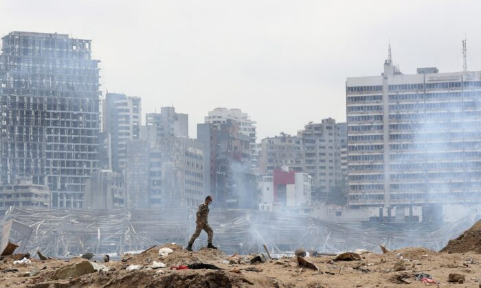 A soldier walks at the devastated site of the explosion in the port of Beirut, Lebanon, on Aug.6, 2020. (Thibault Camus, Pool/AP Photo)