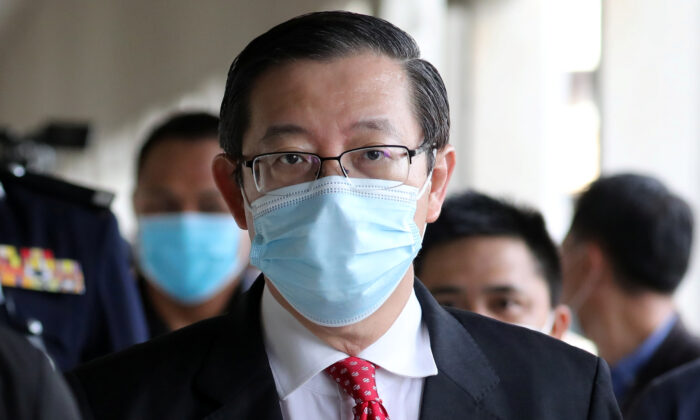 Malaysia's former Finance Minister Lim Guan Eng arrives at Kuala Lumpur High Court in Kuala Lumpur, Malaysia, on Aug. 7, 2020. (Lim Huey Teng/Reuters)