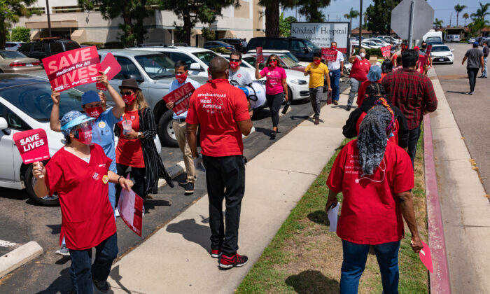 Nurses gather for a rally to demand better protection against the COVID-19 pandemic outside Kindred Hospital Westminster in Westminster, Calif., on Aug. 5, 2020. (John Fredricks/The Epoch Times)