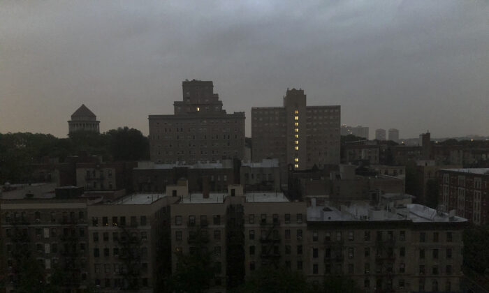 Buildings in Harlem sit dark during a power outage, N.Y., on Aug. 7, 2020. (Candice Choi/AP Photo)