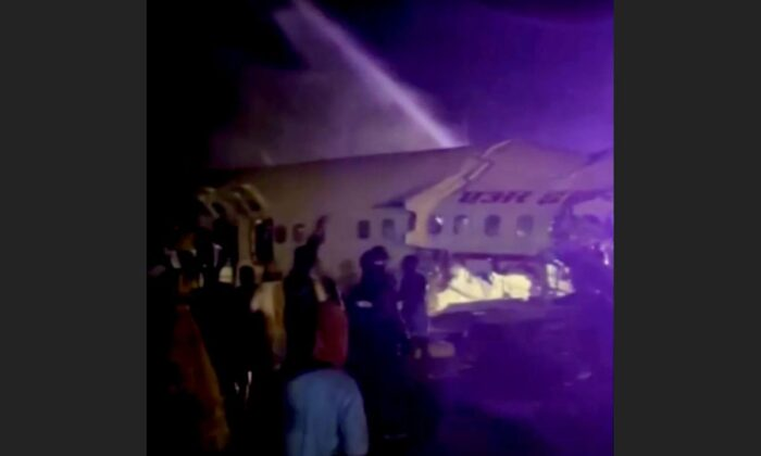 A passenger plane that crashed after it overshot the runway is seen at Calicut International Airport in Karipur, southern state of Kerala, India, on Aug. 7, 2020, in this still image obtained from a video. (ANI/Reuters TV/via Reuters)