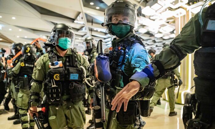 Riot police secure an area inside a shopping mall during a rally in Hong Kong  on July 21, 2020. (Anthony Kwan/Getty Images)