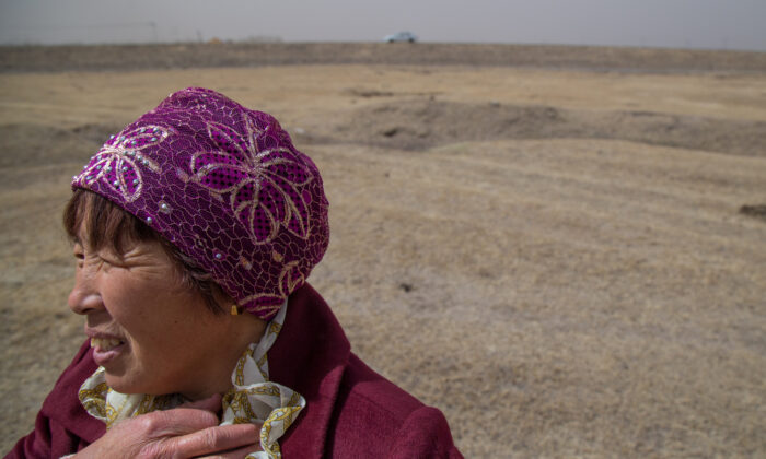 A dairy farmer in Inner Mongolia looks out onto the grasslands in Tuanjiecun, China, on April 30, 2019. (Betsy Joles/ Getty Images)