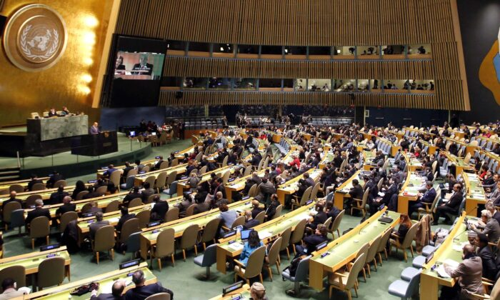People gather at the General Assembly, prior to a vote, Thursday, Dec. 21, 2017, at United Nations headquarters.   (AP Photo/Mark Lennihan)