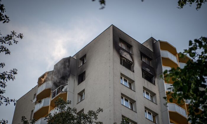 Smoke can still be seen billowing from balconies after a fire broke out in an apartment block in Bohumin, eastern Czech Republic, on Aug. 8, 2020. (Lukas Kabon/AFP via Getty Images)