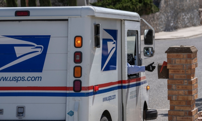 United States Postal Service mail carrier Frank Colon, 59, delivers mail amid the CCP virus pandemic in El Paso, Texas, on April 30, 2020. (Paul Ratje/AFP via Getty Images)