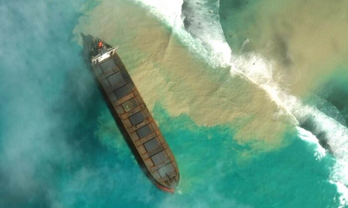 In this satellite image provided by 2020 Maxar Technologies on Aug. 7, 2020, an aerial view of the MV Wakashio, a bulk carrier ship that recently ran aground off the southeast coast of Mauritius. (2020 Maxar Technologies. via AP)