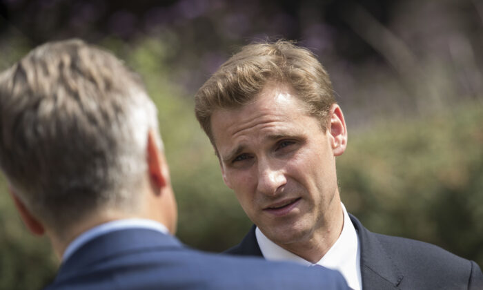 Member of Parliament for Croydon South Chris Philp speaks to members of the press on Abingdon Green in London on July 9, 2018. (John Phillips/Getty Images)