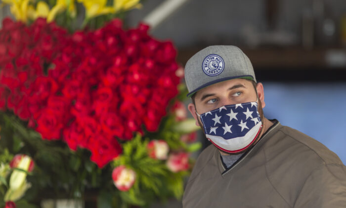 A man wears a patriotic face covering in the Flower District in downtown Los Angeles on May 8, 2020. (David McNew/Getty Images)