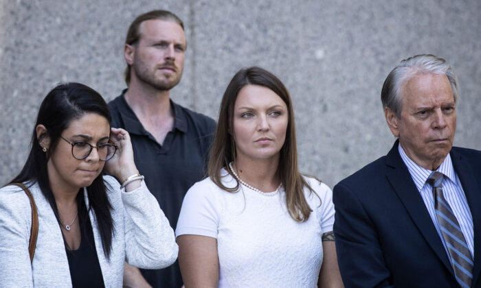 Courtney Wild (C), alleged victim of Jeffrey Epstein, looks on as her lawyers speak to the press at federal court following a bail hearing for Jeffrey Epstein, in New York City on July 15, 2019. (Drew Angerer/Getty Images)