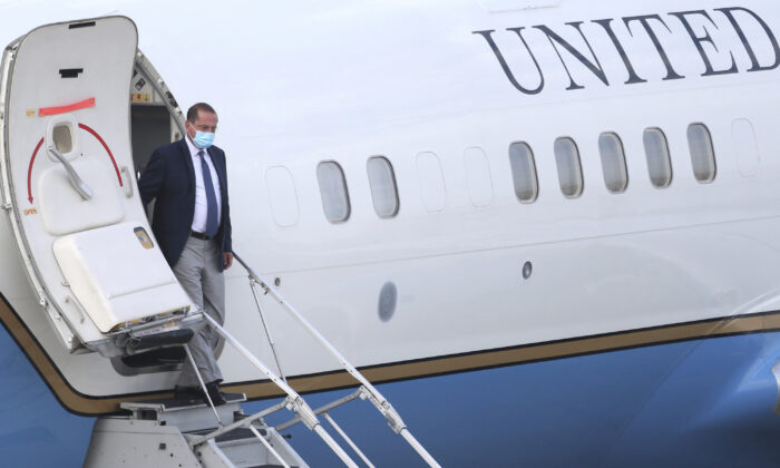 U.S. Health and Human Services Secretary Alex Azar arrives at Taipei Songshan Airport in Taipei, Taiwan, Sunday, Aug. 9, 2020. Azar arrived in Taiwan on Sunday in the highest-level visit by an American Cabinet official since the break in formal diplomatic relations between Washington and Taipei in 1979. (AP Photo/Chiang Ying-ying)