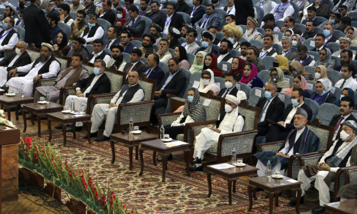 Afghan President Ashraf Ghani, third right, wears a protective face mask to help curb the spread of the coronavirus, attend on the last day of an Afghan Loya Jirga or traditional council, in Kabul, Afghanistan, Sunday, Aug. 9, 2020. (AP Photo)