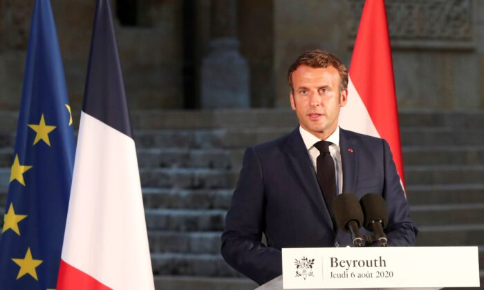 French President Emmanuel Macron delivers his speech during a news conference, following Tuesday's blast in Beirut's port area, in Beirut, Lebanon, on Aug. 6, 2020. (Thibault Camus/Pool via Reuters)