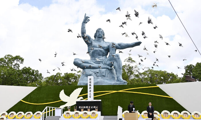 Doves fly over the Statue of Peace during a ceremony at Nagasaki Peace Park in Nagasaki, Japan, on Aug. 9, 2020. (Kyodo News via AP)