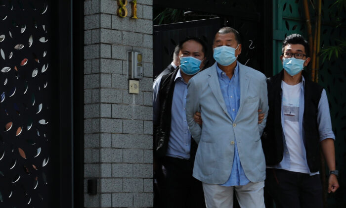 Media mogul Jimmy Lai Chee-ying, founder of Apple Daily (C) is detained by the national security unit in Hong Kong on Aug. 10, 2020. (Tyrone Siu/Reuters)