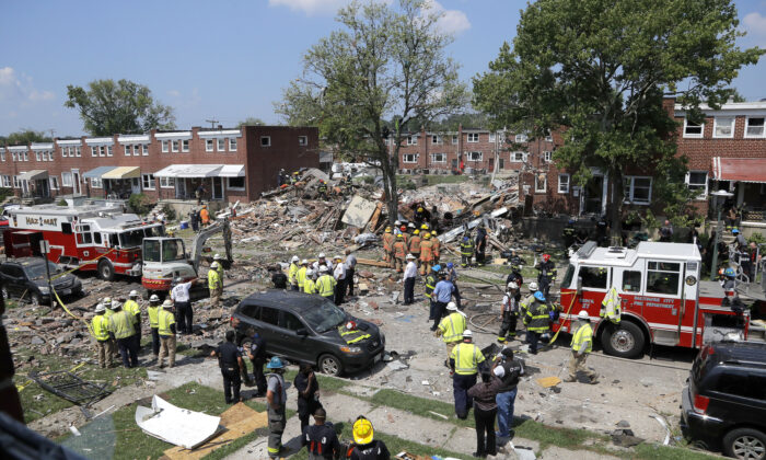 Rescue officials work near the rubble in the aftermath of an explosion in Baltimore, Md., on Aug. 10, 2020.  (Julio Cortez/AP Photo)