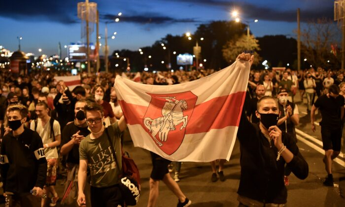 Opposition supporters protest after polls closed in Belarus' presidential election, in Minsk, on Aug. 9, 2020. (Sergei Gapon/AFP via Getty Images)