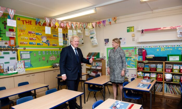 Britain's Prime Minister Boris Johnson (L) talks with head teacher Bernadette Matthews (R) as he visits St Joseph's Catholic Primary School in Upminster, East London, on Aug. 10, 2020. (Lucy Young/Pool/AFP via Getty Images)