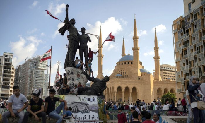 People gather at Martyrs' Square in Beirut as demonstrators took to the streets to protest against government corruption following the deadly explosion that devastated large parts of the city, in Lebanon on Aug. 9, 2020. (AP Photo/Felipe Dana)