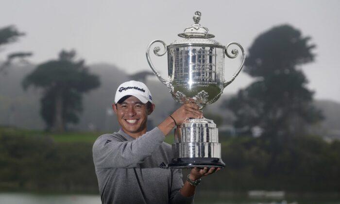 Collin Morikawa holds the Wanamaker Trophy after winning the PGA Championship golf tournament at TPC Harding Park on Aug. 9, 2020, in San Francisco, California. (Jeff Chiu/AP Photo)