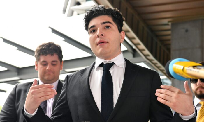 Drew Pavlou is seen talking to the media outside the Brisbane Magistrates Court in Brisbane, Australia, on Aug. 10, 2020. (Darren England/AAP Image)