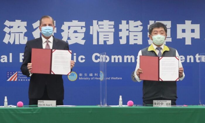 US Health Secretary and Human Rights Services Alex Azar (L) and Taiwan's Minister of Health and Welfare Chen Shih-chung display signed documents at the Central Epidemic Command Center in Taipei on Aug. 10, 2020. (Pei Chen/POOL/AFP via Getty Images)