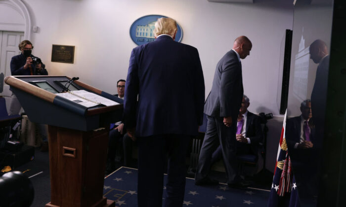 A U.S. Secret Service agent tells President Donald Trump to leave the briefing room after shots were reported fired near the White House in Washington on Aug. 10, 2020. (Alex Wong/Getty Images)