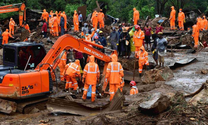 Rescue workers search for missing people at a landslide site caused by heavy rains in Pettimudy, in Kerala state, on Aug. 8, 2020. (STR/AFP via Getty Images)