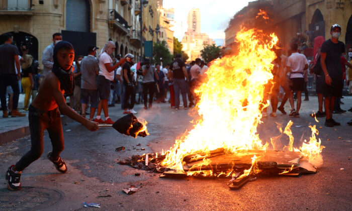 Demonstrators take part in anti-government protests that have been ignited by a massive explosion in Beirut, Lebanon, on Aug. 10, 2020. (Hannah McKay/Reuters)