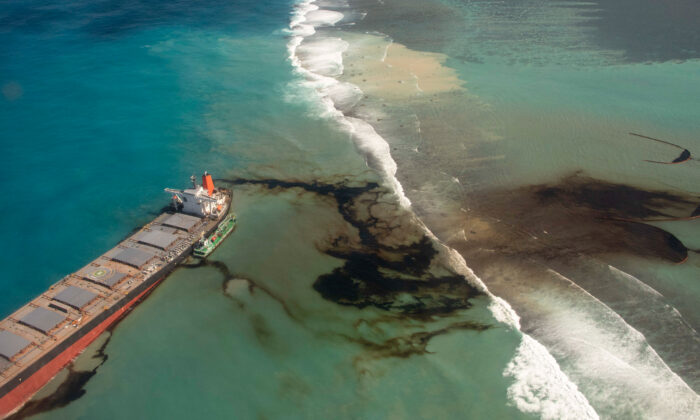 The French Defense Ministry shows oil leaking from the MV Wakashio, a bulk carrier ship that recently ran aground off the southeast coast of Mauritius on Aug.9, 2020. (Gwendoline Defente/EMAE via AP)