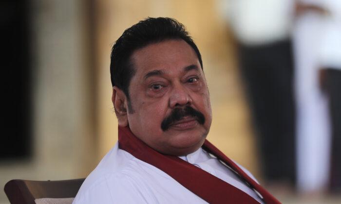 Sri Lanka's former President Mahinda Rajapaksa, waits to be sworn in as the prime minister at Kelaniya Royal Buddhist temple in Colombo, Sri Lanka on Aug. 9, 2020. (AP Photo/Eranga Jayawardena)