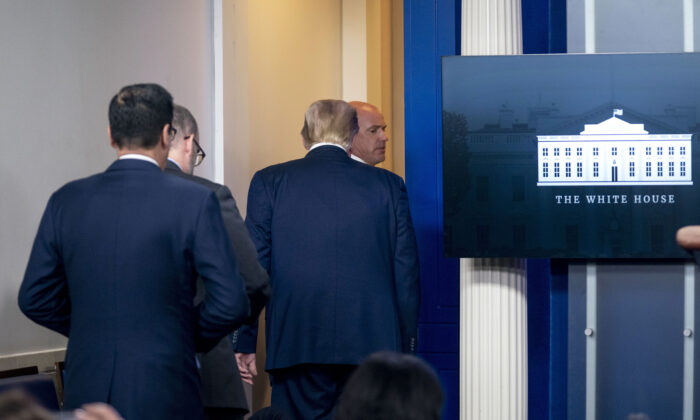 President Donald Trump is asked to leave the James Brady Press Briefing Room by a member of the U.S. Secret Service during a news conference at the White House, on Aug. 10, 2020. (Andrew Harnik/AP Photo)