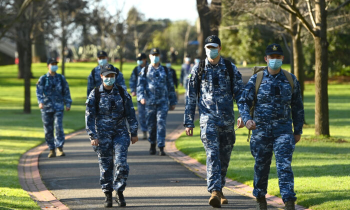 Members of the Australian Defence Force walk through Fitzroy Gardens in Melbourne on August 10, 2020  as the city  is under stage 4 lockdown restrictions ( Quinn Rooney/Getty Images)
