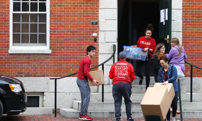 Students move out of dorm rooms on Harvard Yard on the campus of Harvard University in Cambridge, Mass. on March 12, 2020. (Maddie Meyer/Getty Images)