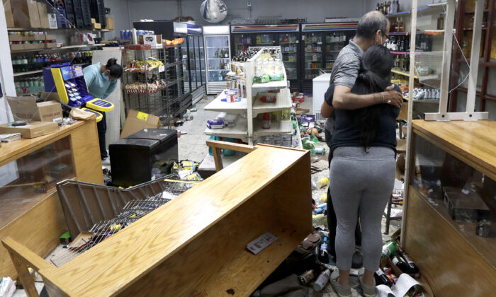 Kajal Dalal walks through her family's food and liquor store after it was vandalized in downtown Chicago Aug. 10, 2020. (Charles Rex Arbogast/AP Photo)