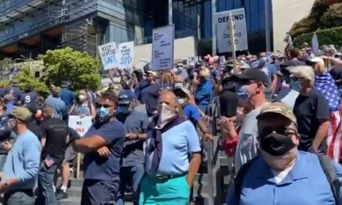 "In this still image via video, ralliers chant during a ""back the blue"" rally in Seattle, Wash., on Aug. 9, 2020. (Katie Daviscourt via The Epoch Times)"