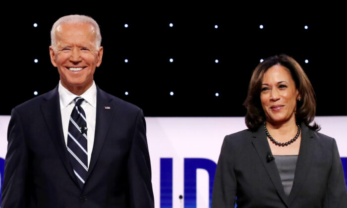 Democratic presidential candidates former Vice President Joe Biden (L) and Sen. Kamala Harris (D-Calif.) take the stage at the Democratic Presidential Debate at the Fox Theatre in Detroit, Mich., on July 31, 2019. (Justin Sullivan/Getty Images)