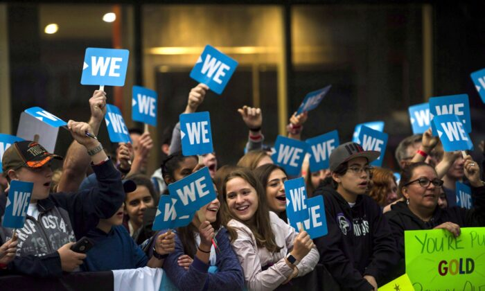A crowd gathers by the red carpet before a WE Day event in Toronto on Sept. 20, 2018. (The Canadian Press/Christopher Katsarov)