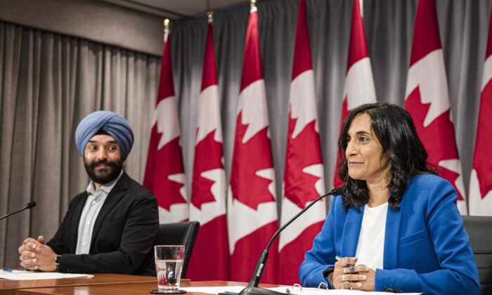 Innovation Minister Navdeep Bains and Minister of Public Services and Procurement Anita Anand make an announcement regarding vaccine procurement in Toronto on Aug., 5, 2020. (The Canadian Press/Christopher Katsarov)