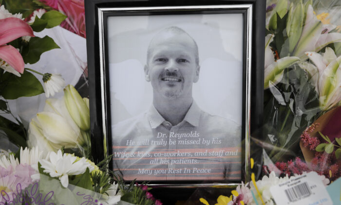An impromptu memorial for Dr. Walter Reynolds, who died after he was attacked in an examination room rests outside the Village Mall walk-in clinic in Red Deer, Alta., on Aug. 11, 2020. (Jeff McIntosh/The Canadian Press)