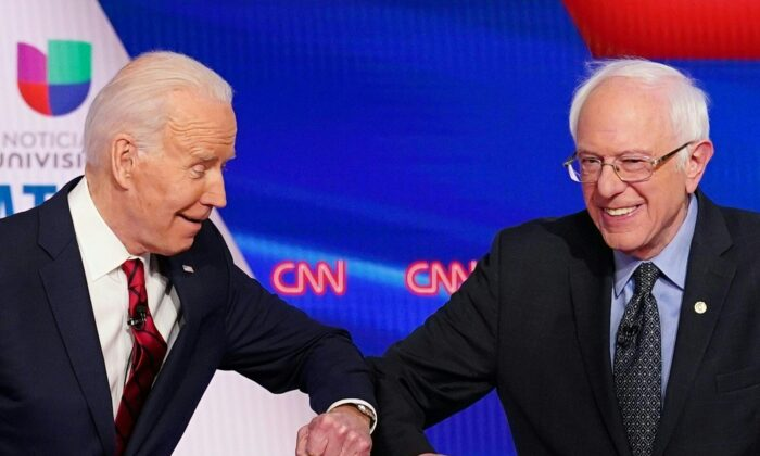 Democratic presidential hopefuls former Vice President Joe Biden (L) and Sen. Bernie Sanders greet each other with a safe elbow bump before the start of the 11th Democratic Party 2020 presidential debate in a CNN Washington Bureau studio in Washington on March 15, 2020. (Mandel Ngan/AFP via Getty Images)