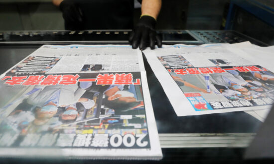 Beijing-Backed Officials and Media Threaten to Shut Down Hong Kong's 'Apple Daily' Newspaper