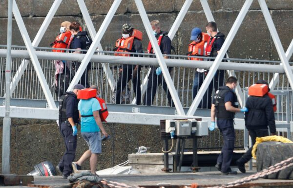 Migrants disembark after arriving at Dover harbour, Britain.