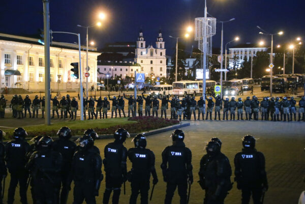 Police block a square during a mass protest following presidential elections in Minsk, Belarus,